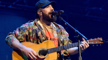 [Listen] Sam Hunt Delivers HauntingRendition of'This Land Is Your Land'