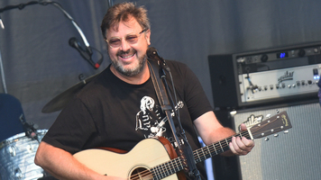 Hot Shots: See Vince Gill Hit The Stage In These Exclusive Pics
