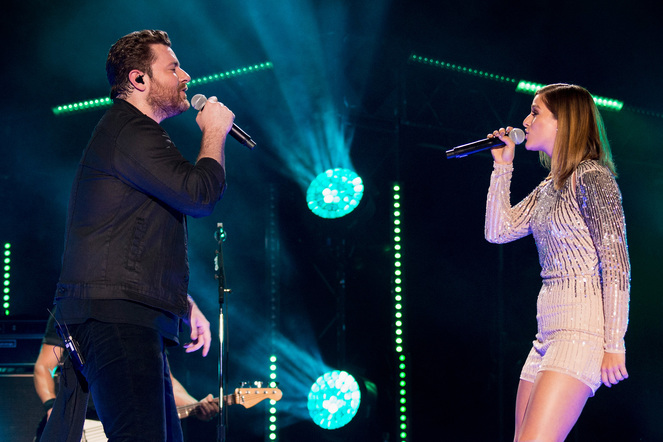 Chris Young and Cassadee Pope perform on the Nissan Stadium stage during day 3 of the 2017 CMA Music Festival on June 10, 2017 in Nashville, Tennessee.