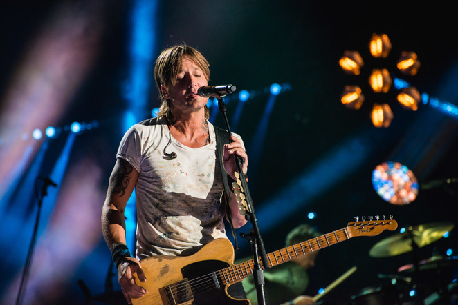 Keith Urban performs on the Nissan Stadium stage during day 4 of the 2017 CMA Music Festival on June 11, 2017 in Nashville, Tennessee.