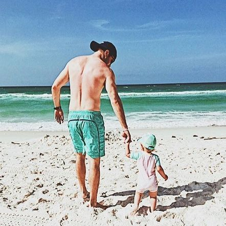 Jacob Davis celebrates being a dad on Father's Day with his little pride and joy at the beach!