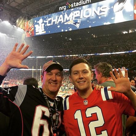 Scotty McCreery celebrated with a picture of him and his pops at a Falcon's game!