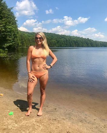 Carrie Underwood showed off her summer bod and a swimsuit from her 'Calia By Carrie' line while vacationing with her family at the lake!