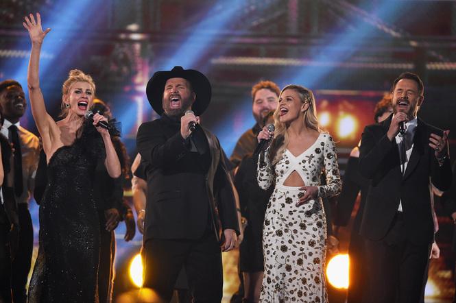 Faith Hill, Garth Brooks, Kelsea Ballerini, and Jimi Westbrook perform onstage at the 51st annual CMA Awards at the Bridgestone Arena on November 8, 2017 in Nashville, Tennessee.