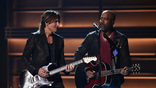 Keith Urban and Darius Rucker perform onstage at the 51st annual CMA Awards at the Bridgestone Arena on November 8, 2017 in Nashville, Tennessee.