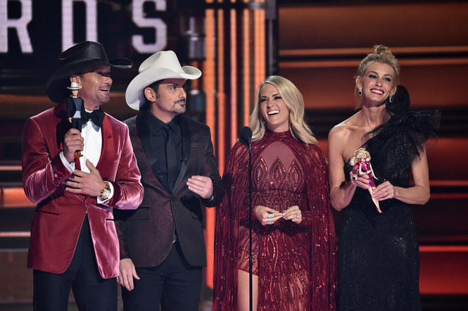 Memorable Moments From 2017 CMA AwardsTim McGraw, Brad Paisley, Carrie Underwood, and Faith Hill speak onstage at the 51st annual CMA Awards at the Bridgestone Arena on November 8, 2017 in Nashville, Tennessee.