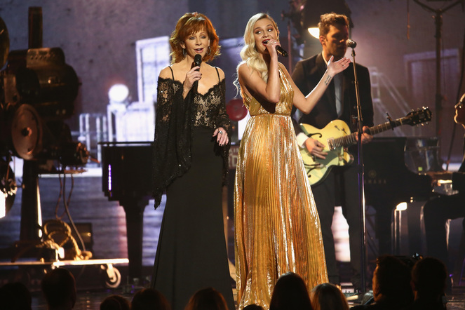 Reba McEntire and Kelsea Ballerini perform onstage at the 51st annual CMA Awards at the Bridgestone Arena on November 8, 2017 in Nashville, Tennessee.