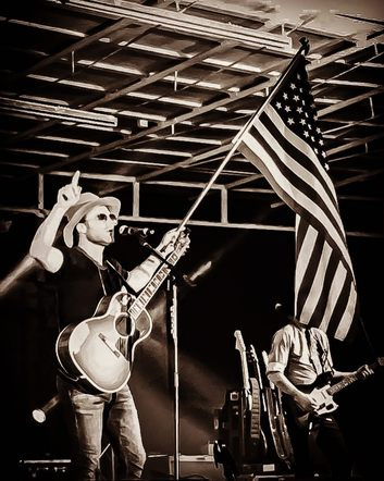 Drake White posted a photo with an American Flag on stage, with a message thanking our troops for his freedom.