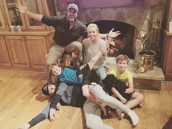 Luke Bryan and his family posted for an adorable photo on Thanksgiving around the fireplace.