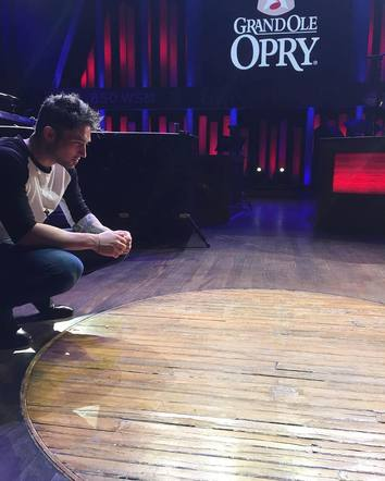 Michael Ray took a moment to remember all of the icons who have performed in this circle at the Ryman.