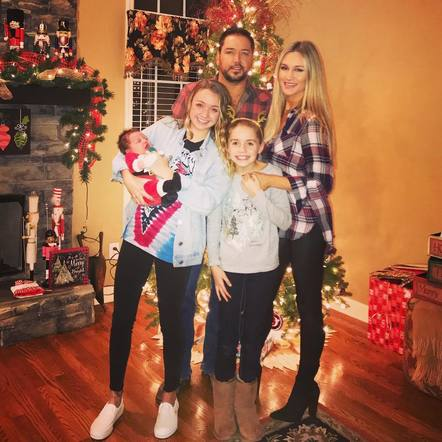 Jason Aldean celebrated Christmas with his wife and ever growing family by his side.