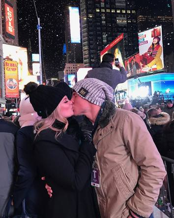 Lauren Alaina smooches with her man on New Years Eve.