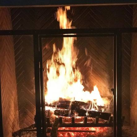 Tim McGraw stayed toasty from the cold by his fireplace.