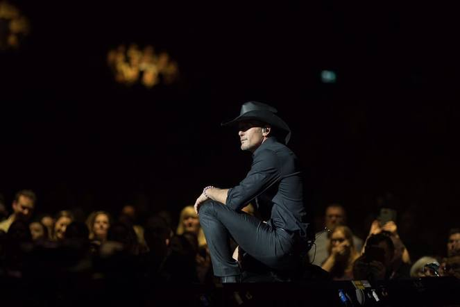 Tim McGraw dressed in all black to take the stage in London.